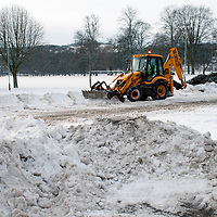Perth Snow & Ice....04.01.10...A JCB at work on Perth's South Inch car park attempting to clear the huge amounts of snow and ice that has built up over the last week, in preparation of people returning to work tomorrow.<br /> Picture by Graeme Hart.<br /> Copyright Perthshire Picture Agency<br /> Tel: 01738 623350  Mobile: 07990 594431