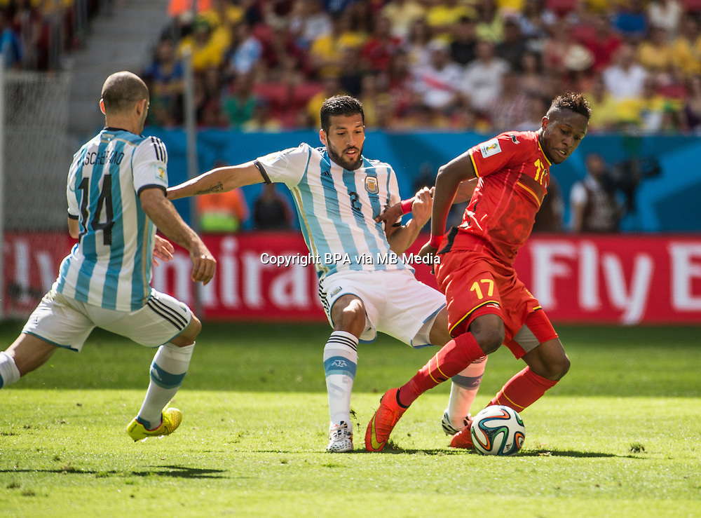 Ezequiel Garay and Divock Origi. Argentina v Belgium, quarter-final. FIFA World Cup 2014 Brazil. National stadium, Brasilia. 05 July 2014