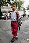 INDONESIA, Central Java, Yojakarta, young student visiting the main Palace