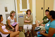 Members of Learning Communities Arts and Sciences Group A, (from left) Katina Viggiano, Melanie Vonwahlde, Karen Dahn, Ted Dacey and Denise McCain, get to know each other during the Learning Communities Meeting Sunday evening in the Baker Hall Ballroom.