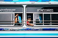 Kandy, Sri Lanka -- January 31, 2018: A young man peers out of a bus window.