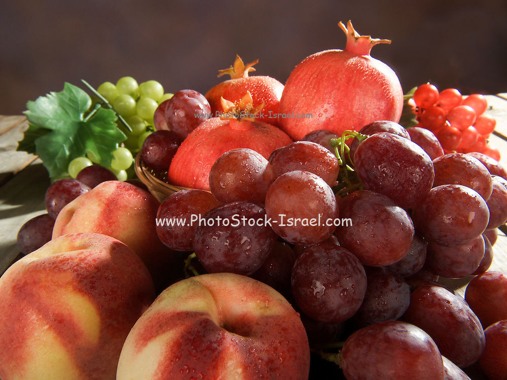 fresh Fruit Basket with grapes, peaches and pomegranate