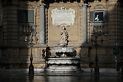 Fountain of one of the four Baroque buildings closing the octagonal Quattro Canti square, officially known as Piazza Vigliena, Palermo, Sicily, Italy. It was laid out in 1608-1620 by Giulio Lasso at the crossing of two principal streets and was one of the first major examples of town planning in Europe. Picture by Manuel Cohen