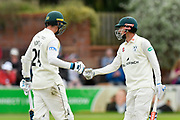 Josh Tongue of Worcestershire and Ed Barnard of Worcestershire touch gloves during the Specsavers County Champ Div 1 match between Somerset County Cricket Club and Worcestershire County Cricket Club at the Cooper Associates County Ground, Taunton, United Kingdom on 22 April 2018. Picture by Graham Hunt.
