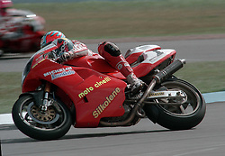 JAMES WHITHAM MOTO CINELLI DUCATI BATTLES WITH CARL FOGARTY DUCATI ON INSIDE FOR THE FINISH LINE, BRITISH SUPERBIKE CHAMP, HEAT, British Supercup Championship Donington 4th April 1994