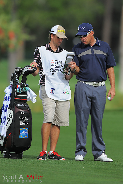 Brian Davis and his caddie during the first round of the Honda Classic at PGA National on March 1, 2012 in Palm Beach Gardens, Fla. ..©2012 Scott A. Miller.