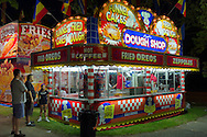 People are lined up at Dough Shop booth that sells zeppoles, funnel cakes, fried Oreos, and more, during the first day of the annual Herricks Community Fund Spring Carnival, which raises funds for programs that enrich the community and school district. The Long Island carnival runs through June 2.