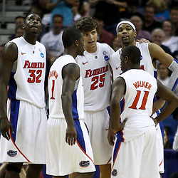 Mar 26, 2011; New Orleans, LA; Florida Gators center Vernon Macklin (32), Kenny Boynton (1), Chandler Parsons (3), Erving Walker (11) and Alex Tyus (23) huddle up during overtime in the semifinals of the southeast regional of the 2011 NCAA men's basketball tournament against the Butler Bulldogs at New Orleans Arena. Butler defeated Florida 74-71.  Mandatory Credit: Derick E. Hingle