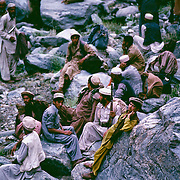 Mujahadeen fighters rest as they walk through the Hindu Kush Valley in Afghanistan 1982 during the war with the Soviet Union.