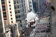 A Diary of a Wimpy Kid balloon goes down 6th Avenue for the 89th annual Macy's Thanksgiving Day Parade as seen from above street level on Thursday, Nov. 26, 2015, in New York. (Photo by Ben Hider/Invision/AP)