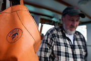 Dave Casoni, a Massachusetts lobster fisherman, walks out of the wheel house of is boat the Margaret M in Sandwich Mass. (Lathan Goumas)
