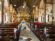 22 DECEMBER 2014 - BANGKOK, THAILAND: The interior of Santa Cruz Catholic Church in Bangkok. There has been a Catholic church on the site since 1770. The current church was finished in 1916. It is one of the oldest Catholic churches in Thailand. Now the neighborhood around the church is known for the Thai adaptation of Portuguese cakes baked in the neighborhood. Several hundred Siamese (Thai) Buddhists converted to Catholicism in the 1770s. Some of the families started baking the cakes. When the Siamese Empire in Ayutthaya was sacked by the Burmese, the Portuguese and Thai Catholics fled to Thonburi, in what is now Bangkok. The Portuguese established a Catholic church near the new Siamese capital. There are still a large number of Thai Catholics living in the neighborhood around the church.      PHOTO BY JACK KURTZ