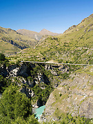 AJ Hackett's private suspension bridge for bungy jumping; Looking down Skipper's Canyon and the Shotover River, near Queenstown, Otago, New Zealand.  Skipper's Canyon is an historical gold mining area of the Otago Region.
