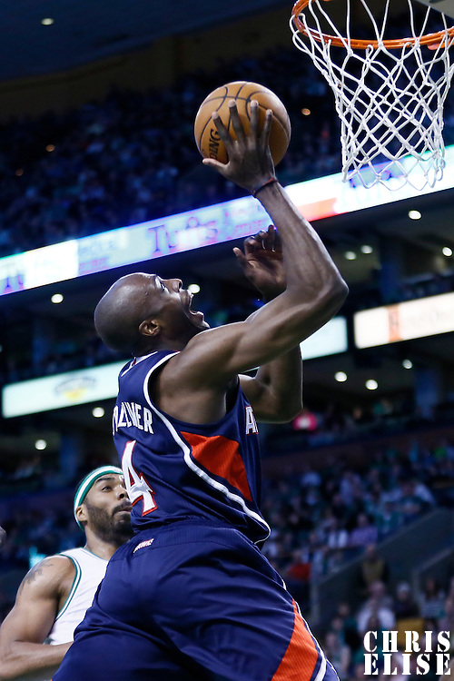 29 March 2013: Atlanta Hawks power forward Anthony Tolliver (4) goes for the layup during the Boston Celtics 118-107 victory over the Atlanta Hawks at the TD Garden, Boston, Massachusetts, USA.