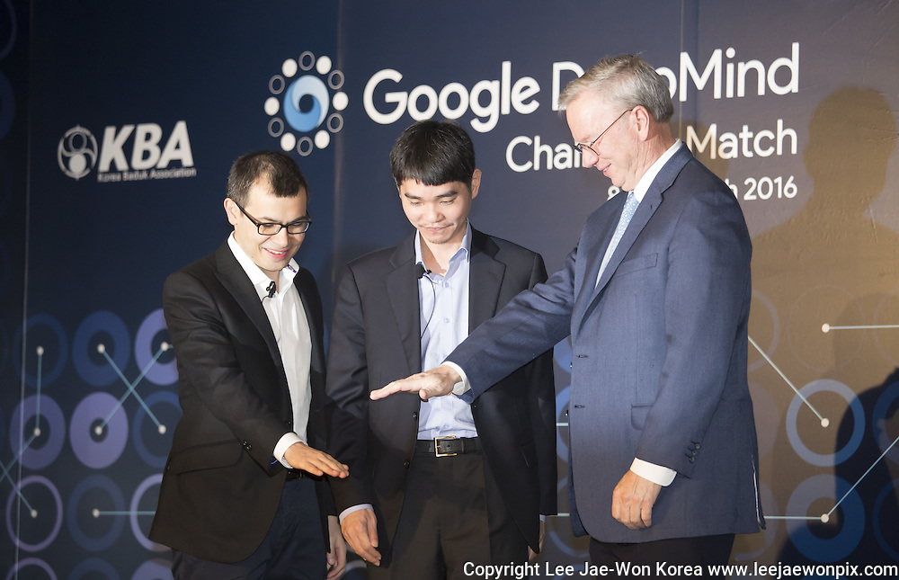 Google Chairman Eric Schmidt (R), South Korean Go master Lee Se-dol (C) and Demis Hassabis, CEO of the AlphaGo developer Google DeepMind, attend a pre-match press conference in Seoul, South Korea, Mar 8, 2016. The historic human-computer showdown in the ancient board game begins on Wednesday in Seoul, with the winner's prize of US$1 million at stake. The matches will be also held at the same place on Thursday, Saturday and Sunday and will end next Tuesday. The prize will be donated to UNICEF and other charities, if AlphaGo wins, local media reported. Photo by Lee Jae-Won (SOUTH KOREA)  www.leejaewonpix.com