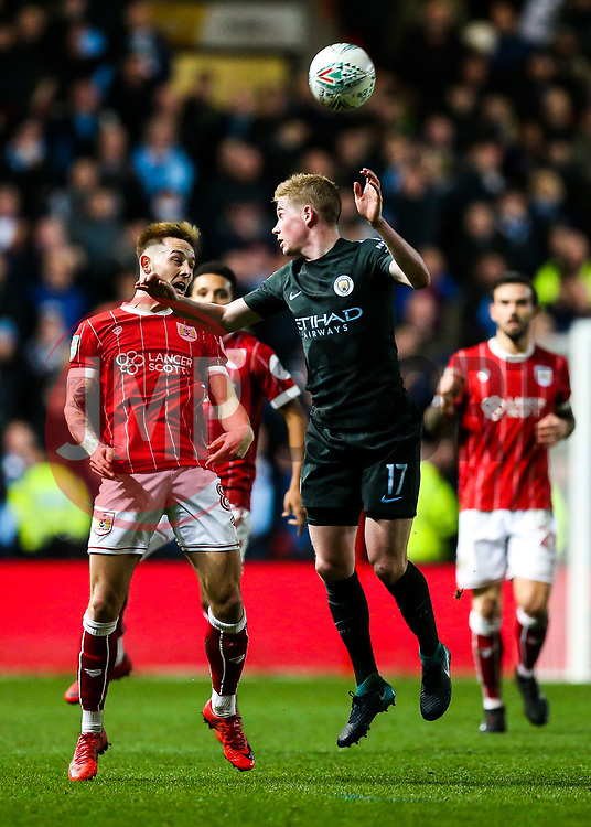 Josh Brownhill of Bristol City and Kevin De Bruyne of Manchester City compete for the ball - Rogan/JMP - 23/01/2018 - Ashton Gate Stadium - Bristol, England - Bristol City v Manchester City - Carabao Cup Semi Final Second Leg.