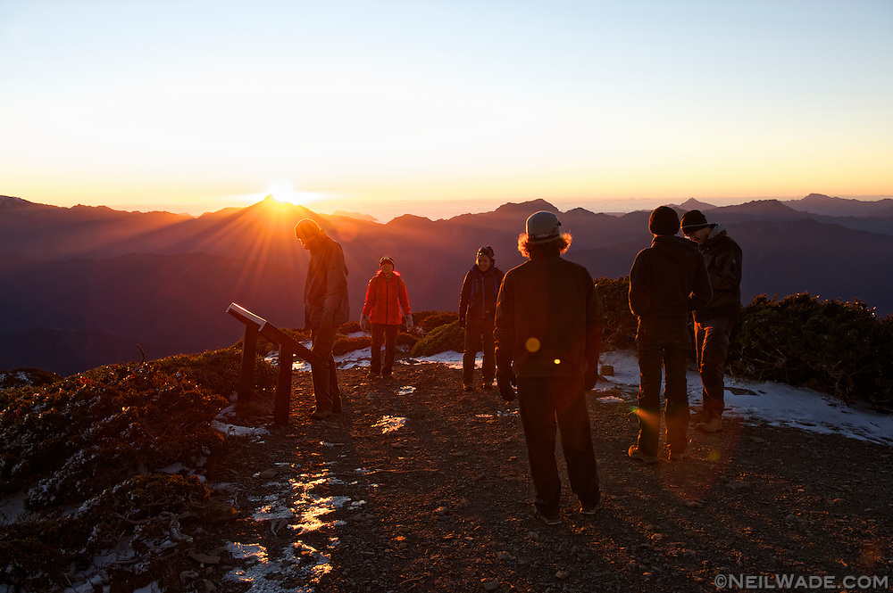 Our hiking group admires the sunrise behind Zhongyang Jianshan from the Snow Mountain Peak.