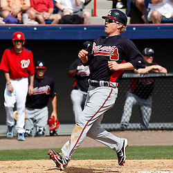 March 4, 2011; Viera, FL, USA; Atlanta Braves outfielder Nate McLouth (13)scores during a spring training exhibition game against the Washington Nationals at Space Coast Stadium.  Mandatory Credit: Derick E. Hingle
