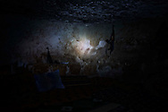Syria. AK-47 are seen in a cave used as base by the Free Syrian Army in a village in Aleppo's province. ALESSIO ROMENZI