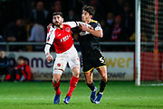 Wimbledon defender Will Nightingale (5) battles with Fleetwood Town forward Ched Evans (9) on loan from Sheffield United,   during the The FA Cup 3rd round match between Fleetwood Town and AFC Wimbledon at the Highbury Stadium, Fleetwood, England on 5 January 2019.