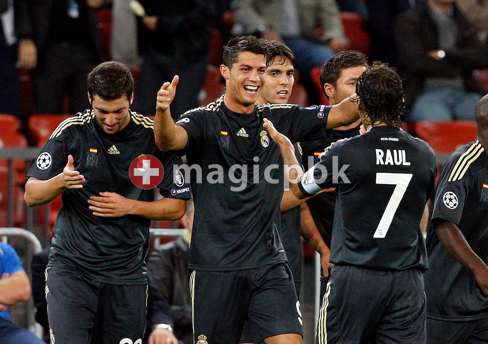 Real Madrid forward Cristiano Ronaldo (C) jubilates after scoring to the score of nil to 1 during to the UEFA Champions League Group C soccer match between Switzerland's FC Zurich and Spain's Real Madrid at the Letzigrund Stadium in Zurich, Switzerland, Tuesday, Sept. 15, 2009. (Photo by Patrick B. Kraemer / MAGICPBK)