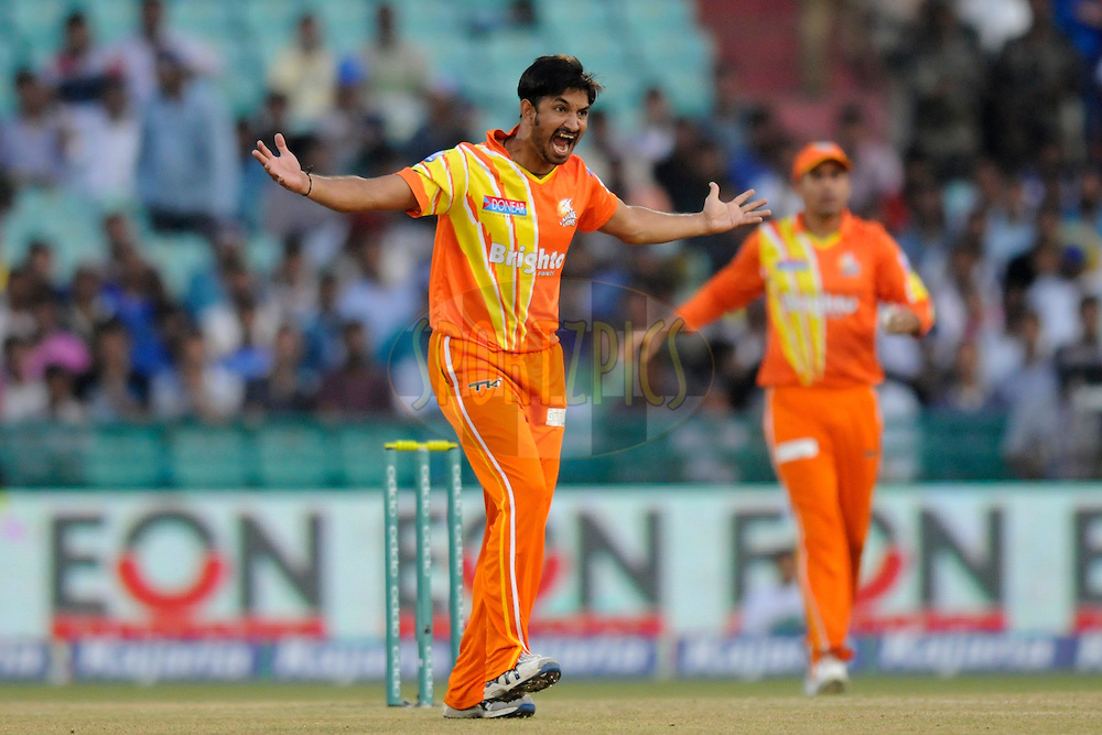 Aizaz Cheema of Lahore Lions appeals unsuccessfully for the wicket of Kusal Perera of Southern Express  during the qualifier 5 match of the Oppo Champions League Twenty20 between the Southern Express and the Lahore Lions held at the Chhattisgarh International Cricket Stadium, Raipur, India on the 16th September 2014<br /> <br /> Photo by:  Pal Pillai / Sportzpics/ CLT20<br /> <br /> <br /> Image use is subject to the terms and conditions as laid out by the BCCI/ CLT20.  The terms and conditions can be downloaded here:<br /> <br /> http://sportzpics.photoshelter.com/gallery/CLT20-Image-Terms-and-Conditions-2014/G0000IfNJn535VPU/C0000QhhKadWcjYs