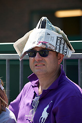 LONDON, ENGLAND - Monday, June 28, 2010: A spectator usues a newspaper as a sun hat on day seven of the Wimbledon Lawn Tennis Championships at the All England Lawn Tennis and Croquet Club. (Pic by David Rawcliffe/Propaganda)