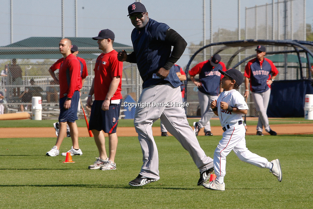February 19, 2011; Fort Myers, FL, USA; Boston Red Sox first baseman David Ortiz and son D'Angelo Ortiz workout together during spring training practice at the Player Development Complex.  Mandatory Credit: Derick E. Hingle