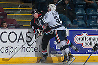 KELOWNA, CANADA - SEPTEMBER 9: Deven Sideroff #34 of Kamloops Blazers checks Kole Lind #16 of Kelowna Rockets into the boards during first period on September 9, 2016 at Prospera Place in Kelowna, British Columbia, Canada.  (Photo by Marissa Baecker/Shoot the Breeze)  *** Local Caption *** Deven Sideroff; Kole Lind;