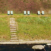 Sunchairs lined up by the Lyn River