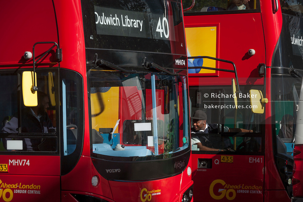 Drivers on the Dulwich route chat through open windows on their journeys along Walworth Road near Elephant & Castle, Southwark.