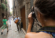 A student practices portraiture with a street musician in Girona, Catalonia.