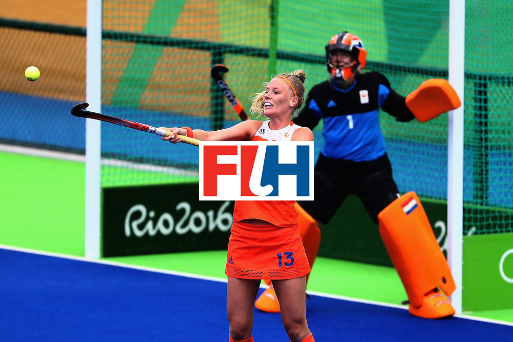RIO DE JANEIRO, BRAZIL - AUGUST 12:  Caia van Maasakker #13 of Netherlands knocks down a ball against New Zealand during a Women's Preliminary Pool A match on Day 7 of the Rio 2016 Olympic Games at the Olympic Hockey Centre on August 12, 2016 in Rio de Janeiro, Brazil.  (Photo by Sean Haffey/Getty Images)