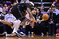 Jan 30, 2017; Phoenix, AZ, USA; Phoenix Suns center Tyson Chandler (4) dives to save the ball in front of Memphis Grizzlies forward Zach Randolph (50) in the second half of the NBA game at Talking Stick Resort Arena. The Memphis Grizzlies won 115-96. Mandatory Credit: Jennifer Stewart-USA TODAY Sports