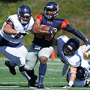 Orange Coast College Running Back #20 Derrick Hunt runs through Fullerton defenders #93 James Napolitano (left) and #43 Isaac Brown (right) Fullerton defeated Orange Coast 35-14.  11/6/16