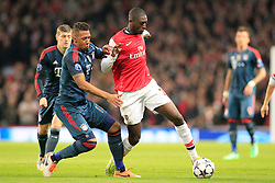 19.02.2014, Emirates Stadion, London, ENG, UEFA CL, FC Arsenal vs FC Bayern Muenchen, Achtelfinale, im Bild Jerome Boateng (FC Bayern Muenchen #17) im Zweikampf gegen / tackling against Yaya Sanogo (Arsenal FC #22), Aktion, Action // during the UEFA Champions League Round of 16 match between FC Arsenal and FC Bayern Munich at the Emirates Stadion in London, Great Britain on 2014/02/19. EXPA Pictures © 2014, PhotoCredit: EXPA/ Eibner-Pressefoto/ Schueler<br /> <br /> *****ATTENTION - OUT of GER*****