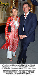MR JAMES LINDSAY and MISS JANE WHITFIELD at a party in London on 25th May 2004.PUK 134