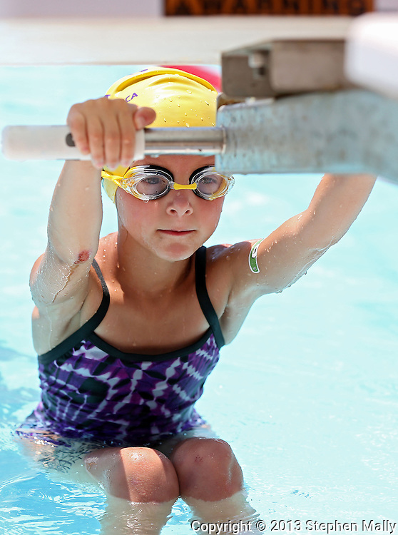 Stoney Point YMCA's Sophia Loeffler, 6, prepares for the start of the Girls 9-10 100 Yard Medley Relay event at the All City Swim Meet at Cherry Hill Aquatic Center in Cedar Rapids on Saturday, July 20, 2013. 623 athletes from ages 4-17 participated in the meet.