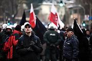 Dresden | 19.11.2011..Neonazis aus ganz Deutschland und aus anderen Ländern Europas planten in Dresden wie in den vergangenen Jahren eine Demonstration (Trauermarsch), um an die Bombardierung Dresdens am 13.02.1945 zu erinnern. Der Tag entwickelte sich für die Neonazis zum Fiasko, über 20000 Demonstranten verhinderten mit Mahnwachen, Demonstrationen und Blockaden die Demo-Versuche der Neonazis..Hier: Neonazis haben sich im Dresdner Ortsteil Plauen versammelt, hier hält ein Neonazi Ausschau nach den Gegendemonstranten...©peter-juelich.com..[No Model Release | No Property Release]