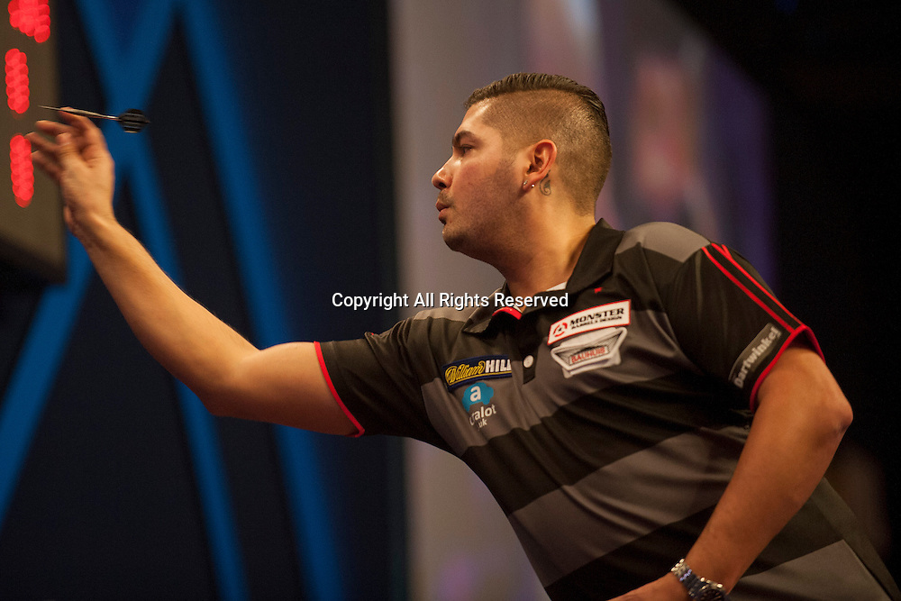 18.12.2014.  London, England.  William Hill PDC World Darts Championship.  Jelle Klaasen (29) [NED] in action during his game with Christian Kist [NED]