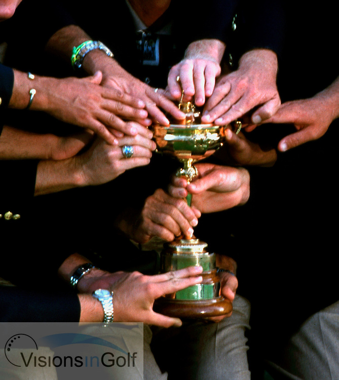 990927/THE COUNTRY CLUB, BROOKLINE, BOSTON,USA/PHOTO MARK NEWCOMBE/ RYDER CUP 1999<br />All the USA teams hands on the trophy after winning<br />RYDER CUP AND VITORIOUS USA TEAM'S HANDS<br />33rd RYDER CUP <br />25-27th SEPTEMBER 1999<br />THE COUNTRY CLUB, BROOKLINE, BOSTON, <br />IAN WOOSNAM WITH VICTORIOUS EUROPEAN TEAM <br />32nd RYDER CUP <br />25-27th SEPTEMBER 1997<br />VALDERAMMA GOLF CLUB, SPAIN