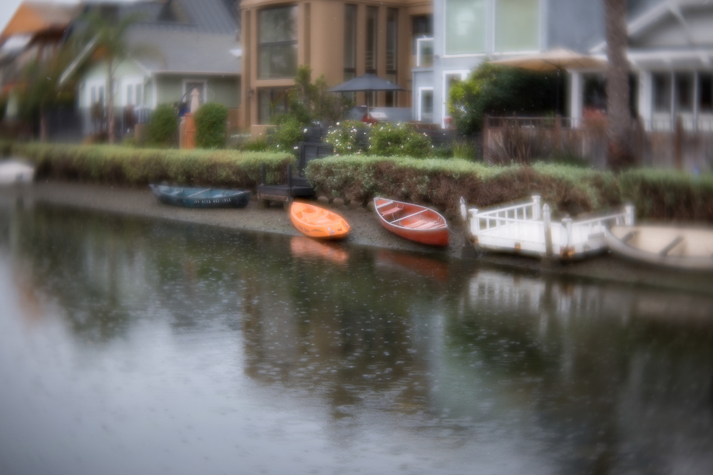 Photo Venice Canal wall art. Canoes, water reflections, rainy day, bokeh. Los Angeles, Westside, Southern California landscape photography. Matted print, limited edition. Fine art photography print.