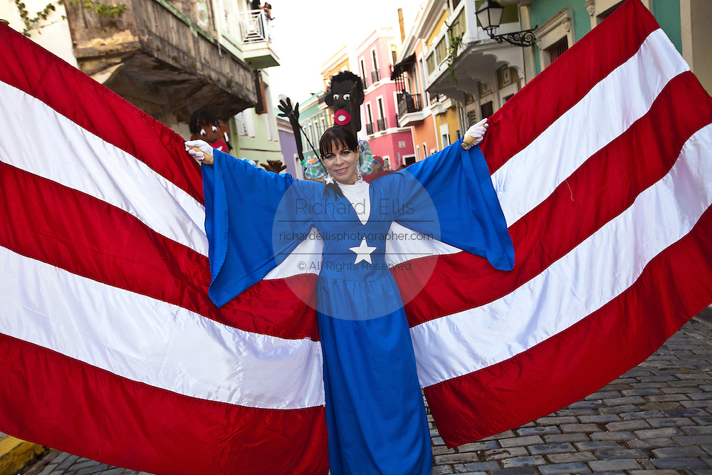 A Costumed reveler parades during the Festival of San Sebastian in San Juan, Puerto Rico.