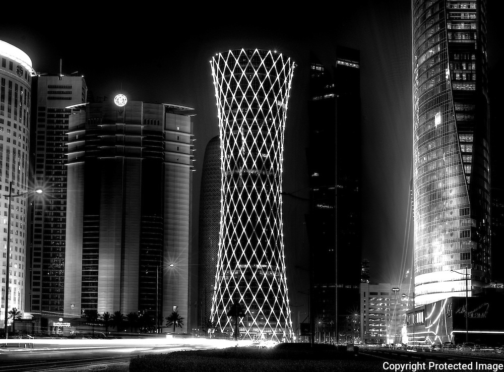 taken in Summer 2011 in the 38 degree heat of Doha, Qatar. These are just a few of the `towers in the West Bay business district of the city. This is a 7 Shot HDR image processed through Photomatix and converted to black and white in Photoshop