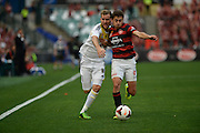 20.10.2013 Sydney, Australia. Wellingtons forward Jeremy Brockie and Wanderers Croatian midfielder Mateo Poljak in action during the Hyundai A League game between Western Sydney Wanderers FC and Wellington Phoenix FC from the Pirtek Stadium, Parramatta. The game ended in a 1-1 draw.
