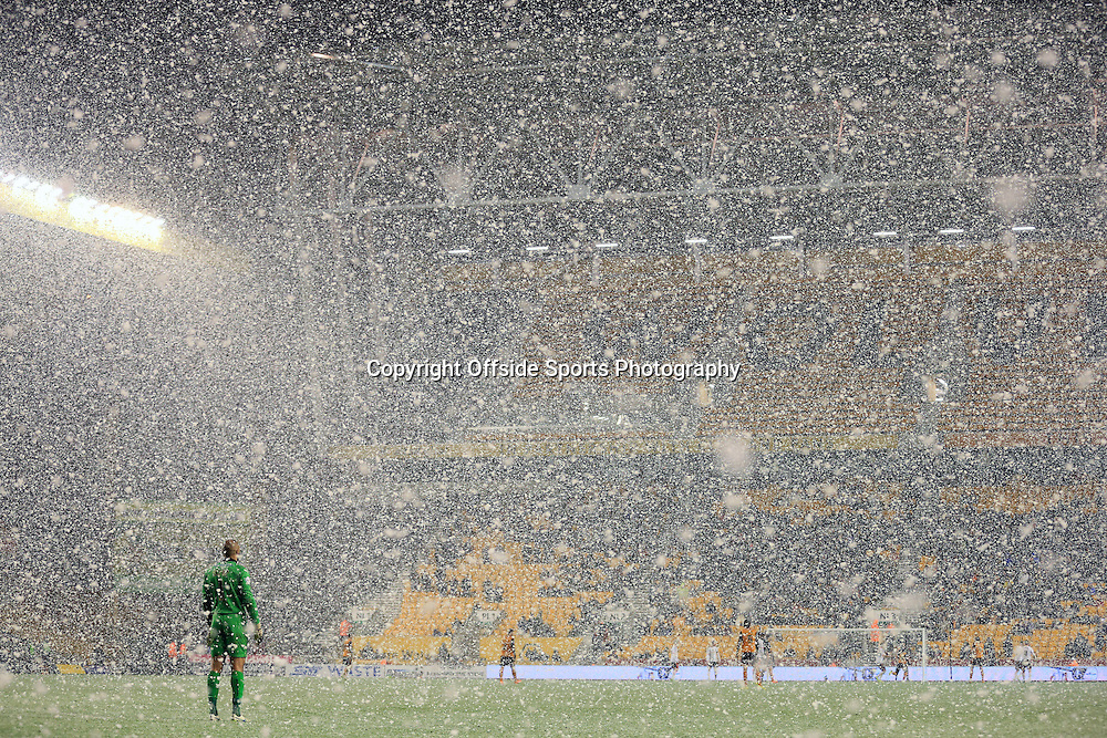 13th January 2015 - FA Cup - 3rd Round Replay - Wolverhampton Wanderers v Fulham - Wolves goalkeeper Carl Ikeme stands in a driving snow blizzard at Molineux - Photo: Simon Stacpoole / Offside.