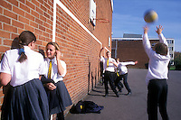 secondary school students playing basketball at recess time.