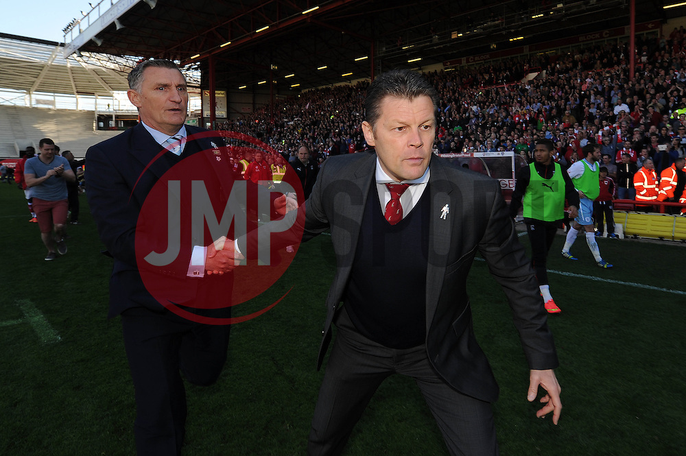 Bristol City manager, Steve Cotterill shakes hands with Coventry City manager, Tony Mowbray as they leave the pitch as fans invade the pitch to celebrate Bristol City winning the league - Photo mandatory by-line: Dougie Allward/JMP - Mobile: 07966 386802 - 18/04/2015 - SPORT - Football - Bristol - Ashton Gate - Bristol City v Coventry City - Sky Bet League One