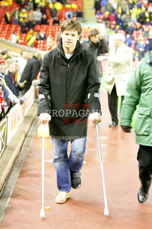 LIVERPOOL, ENGLAND - TUESDAY JANUARY 11th 2005: Liverpool's injured Xabi Alonso walks on crutches before the League Cup Semi-Final 1st Leg against Watford at Anfield. (Pic by David Rawcliffe/Propaganda)