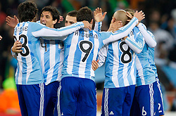 Nicolas Burdisso (4) and other players of Argentina celebrate after the 2010 FIFA World Cup South Africa Round of Sixteen match between Argentina and Mexico at Soccer City Stadium on June 27, 2010 in Johannesburg, South Africa. Argentina defeated Mexico 3-1 and qualified for quarterfinals. (Photo by Vid Ponikvar / Sportida)